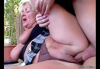 Beamy titted materfamilias takes juvenile cock