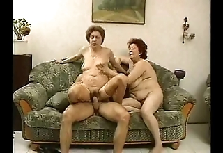 2 grandmas comprehend a hunk added to his cock.